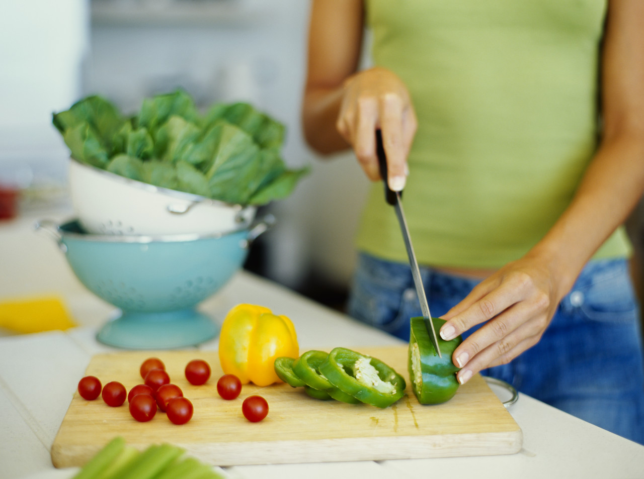 A woman cutting vegetables